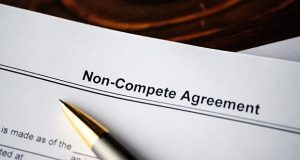 """Close-up of a document reading """"Non-compete agreement"""""""