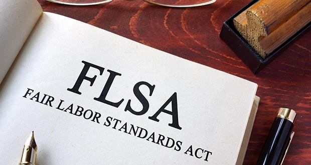 Page reading FLSA on a table