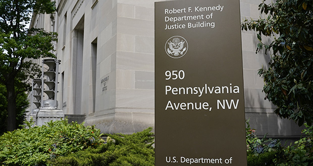 This file photo shows a sign outside the Robert F. Kennedy Department of Justice building in Washington. (AP file photo)