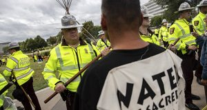 Minnesota State Troopers face off with environmental activists, who identify as water protectors, at the Minnesota State Capitol after activists opposing the Line 3 oil pipeline occupied the site overnight in St. Paul, Minn., Friday, Aug. 27, 2021. (Evan Frost/Minnesota Public Radio via AP)