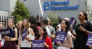 In this June 4, 2019, photo, anti-abortion advocates gather outside the Planned Parenthood clinic in St. Louis. (AP file photo)