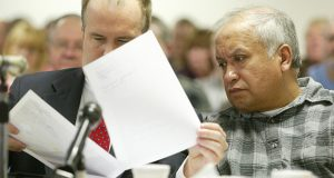 In this March 5, 2004, file photo, Alfonso Rodriguez Jr., right, and his attorney David Dusek, look at photos of the interior of his car presented as evidence during his preliminary hearing in Grand Forks District Court. (AP file photo/Jackie Lorentz, Pool)