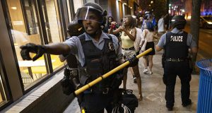Protesters confront police early Saturday, June 5, 2021, in Minneapolis, after a vigil was held for Winston Smith Jr., a Black man who was fatally shot by members of a U.S. Marshals task force. (AP photo: Christian Monterrosa)