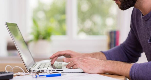 Man working from home on a laptop computer